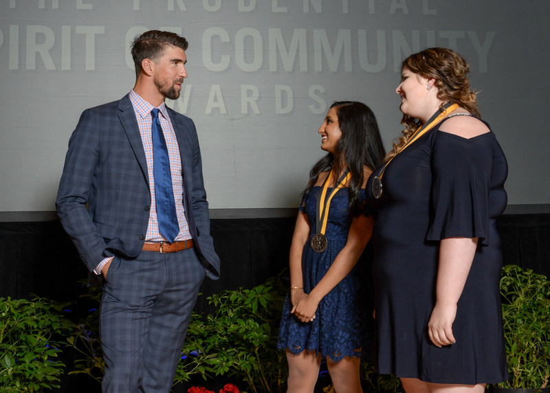 Olympic gold medalist Michael Phelps congratulates Nidhi Mahale, 17, of Fargo (center) and Annabelle Barcomb, 14, of Minot (right) on being named North Dakota's top two youth volunteers for 2017 by The Prudential Spirit of Community Awards. Nidhi and Annabelle were honored at a ceremony on Sunday, May 7 at the Smithsonian's National Museum of Natural History, where they each received a $1,000 award.