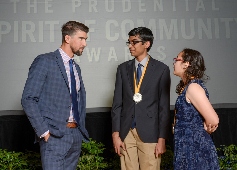 Olympic gold medalist Michael Phelps congratulates Pranit Nanda, 17, of Reno (center) and Athena Morales, 13, of Las Vegas (right) on being named Nevada's top two youth volunteers for 2017 by The Prudential Spirit of Community Awards. Pranit and Athena were honored at a ceremony on Sunday, May 7 at the Smithsonian's National Museum of Natural History, where they each received a $1,000 award.