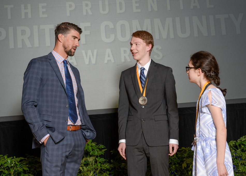 Olympic gold medalist Michael Phelps congratulates Jacob Parker, 18, of Windham (center) and Alexandra Macdonald, 12, of Thornton (right) on being named New Hampshire's top two youth volunteers for 2017 by The Prudential Spirit of Community Awards. Jacob and Alexandra were honored at a ceremony on Sunday, May 7 at the Smithsonian's National Museum of Natural History, where they each received a $1,000 award.