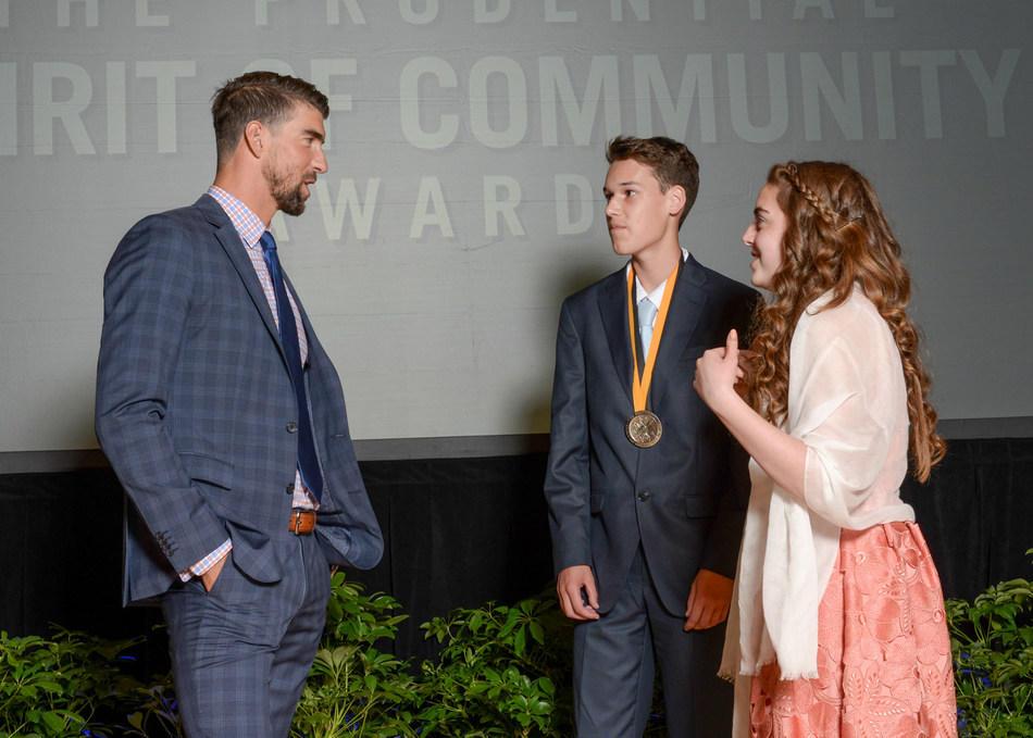 Olympic gold medalist Michael Phelps congratulates Bradley Ferguson, 16, of Northfield (center) and Kierstyn Kuehnle, 13, of Ocean City (right) on being named New Jersey's top two youth volunteers for 2017 by The Prudential Spirit of Community Awards. Bradley and Kierstyn were honored at a ceremony on Sunday, May 7 at the Smithsonian's National Museum of Natural History, where they each received a $1,000 award.