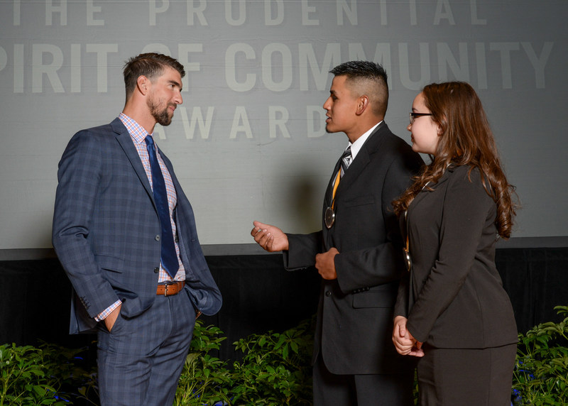 Olympic gold medalist Michael Phelps congratulates Peter Alarid, 18, of Silver City (center) and Alexandra Burnham, 13, of Farmington (right) on being named New Mexico's top two youth volunteers for 2017 by The Prudential Spirit of Community Awards. Peter and Alexandra were honored at a ceremony on Sunday, May 7 at the Smithsonian's National Museum of Natural History, where they each received a $1,000 award.