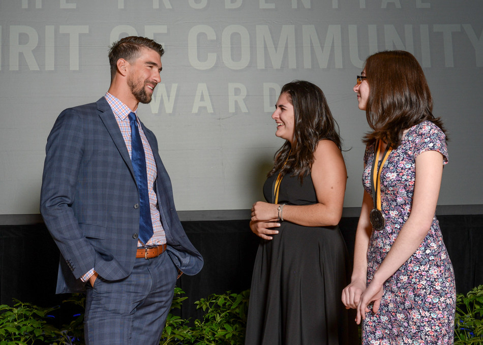 Olympic gold medalist Michael Phelps congratulates Ariana DeMattei, 16, of Center Moriches (center) and Victoria Bonavita, 13, of North Babylon (right) on being named New York's top two youth volunteers for 2017 by The Prudential Spirit of Community Awards. Ariana and Victoria were honored at a ceremony on Sunday, May 7 at the Smithsonian's National Museum of Natural History, where they each received a $1,000 award.