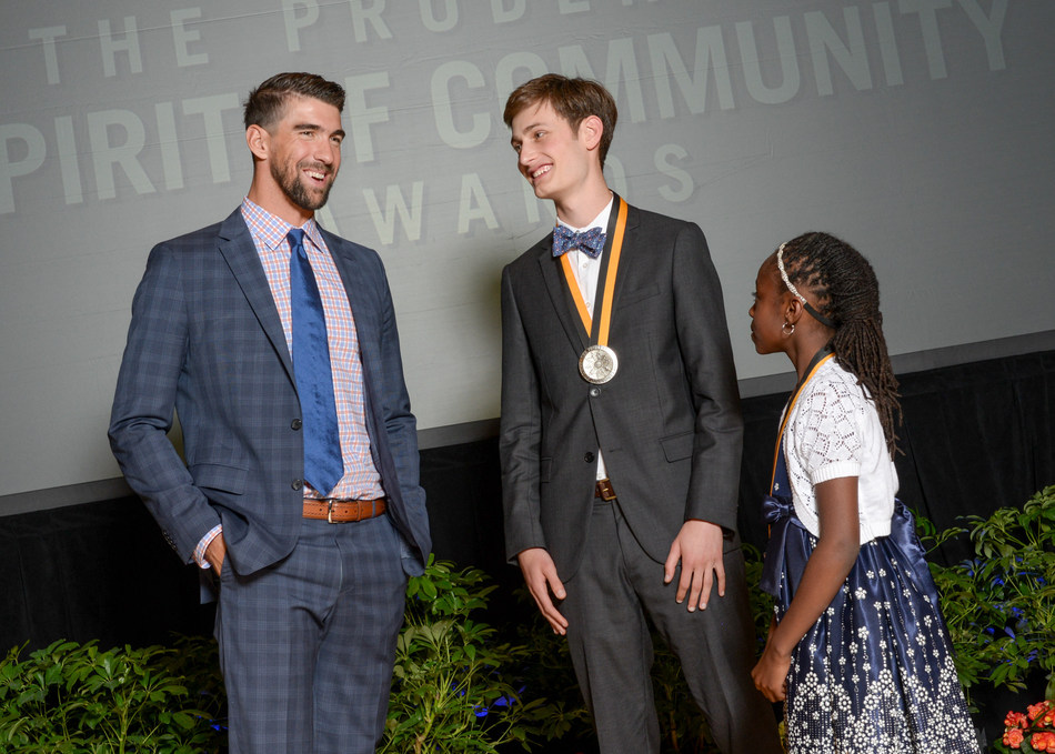 Olympic gold medalist Michael Phelps congratulates Adam Sella, 18, of Cincinnati (center) and Mackenzie Lewis, 10, of Columbus (right) on being named Ohio's top two youth volunteers for 2017 by The Prudential Spirit of Community Awards. Adam and Mackenzie were honored at a ceremony on Sunday, May 7 at the Smithsonian's National Museum of Natural History, where they each received a $1,000 award.