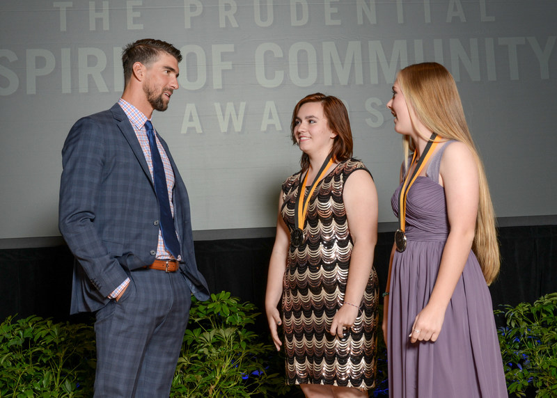 Olympic gold medalist Michael Phelps congratulates Brooke Bollinger, 18, of Blanchard (center) and Ellie Neidel, 14, of Oklahoma City (right) on being named Oklahoma's top two youth volunteers for 2017 by The Prudential Spirit of Community Awards. Brooke and Ellie were honored at a ceremony on Sunday, May 7 at the Smithsonian's National Museum of Natural History, where they each received a $1,000 award.