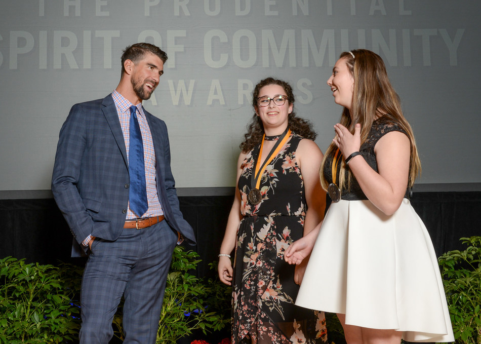 Olympic gold medalist Michael Phelps congratulates Leah Burian, 16, of Portland (center) and Carlie Steele, 12, of Amity (right) on being named Oregon's top two youth volunteers for 2017 by The Prudential Spirit of Community Awards. Leah and Carlie were honored at a ceremony on Sunday, May 7 at the Smithsonian's National Museum of Natural History, where they each received a $1,000 award.