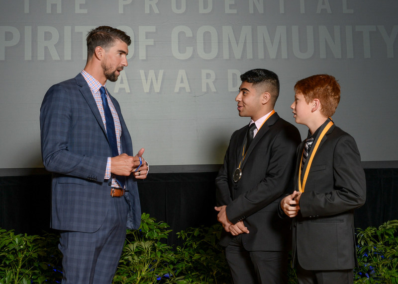 Olympic gold medalist Michael Phelps congratulates Ryan Almusawi, 17, of Fort Worth (center) and Micah Pinson, 12, of Shady Shores (right) on being named Texas' top two youth volunteers for 2017 by The Prudential Spirit of Community Awards. Ryan and Micah were honored at a ceremony on Sunday, May 7 at the Smithsonian's National Museum of Natural History, where they each received a $1,000 award.