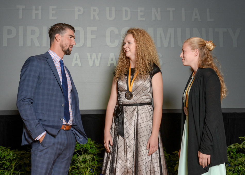 Olympic gold medalist Michael Phelps congratulates Rebekah Reno, 17, of Orem (center) and Kara Hughes, 13, of Bountiful (right) on being named Utah's top two youth volunteers for 2017 by The Prudential Spirit of Community Awards. Rebekah and Kara were honored at a ceremony on Sunday, May 7 at the Smithsonian's National Museum of Natural History, where they each received a $1,000 award.