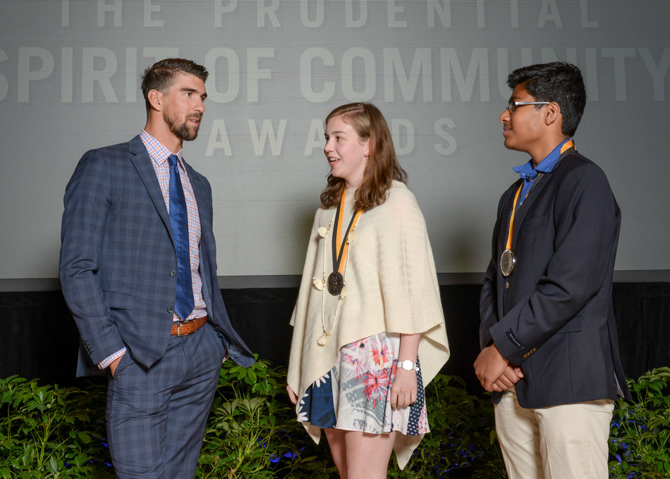 Olympic gold medalist Michael Phelps congratulates Lucia Hoerr, 17, of Charlottesville (center) and Shishir Sriramoju, 14, of Ashburn (right) on being named Virginia's top two youth volunteers for 2017 by The Prudential Spirit of Community Awards. Lucia and Shishir were honored at a ceremony on Sunday, May 7 at the Smithsonian's National Museum of Natural History, where they each received a $1,000 award.