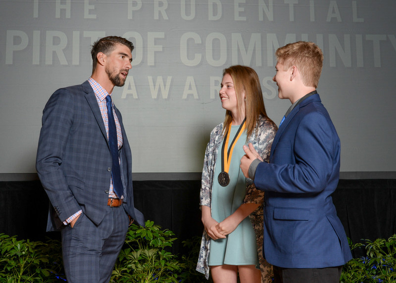 Olympic gold medalist Michael Phelps congratulates Patricia Bell, 18, of Kirkland (center) and Tyler Fiorino, 13, of Spokane (right) on being named Washington's top two youth volunteers for 2017 by The Prudential Spirit of Community Awards. Patricia and Tyler were honored at a ceremony on Sunday, May 7 at the Smithsonian's National Museum of Natural History, where they each received a $1,000 award.