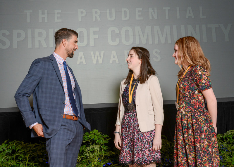 Olympic gold medalist Michael Phelps congratulates Sarah (Katie) Eder, 17, of Shorewood (center) and Julianna Bauknecht, 11, of Bryant (right) on being named Wisconsin's top two youth volunteers for 2017 by The Prudential Spirit of Community Awards. Sarah (Katie) and Julianna were honored at a ceremony on Sunday, May 7 at the Smithsonian's National Museum of Natural History, where they each received a $1,000 award.