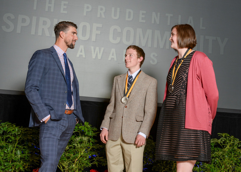 Olympic gold medalist Michael Phelps congratulates Rhett Pimentel, 17, of Powell (center) and Grace Estes, 14, of Farson (right) on being named Wyoming's top two youth volunteers for 2017 by The Prudential Spirit of Community Awards. Rhett and Grace were honored at a ceremony on Sunday, May 7 at the Smithsonian's National Museum of Natural History, where they each received a $1,000 award.