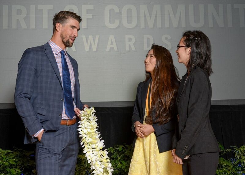 Olympic gold medalist Michael Phelps congratulates Cierra Nakamura, 18, of Honolulu (center) and Emma Tandara, 14, of Ewa Beach (right) on being named Hawaii's top two youth volunteers for 2017 by The Prudential Spirit of Community Awards. Cierra and Emma were honored at a ceremony on Sunday, May 7 at the Smithsonian's National Museum of Natural History, where they each received a $1,000 award.