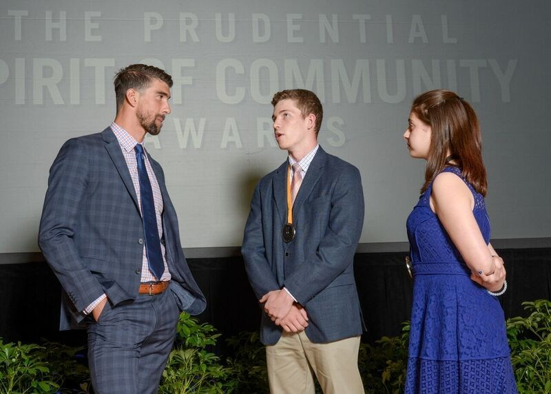 Olympic gold medalist Michael Phelps congratulates Max Hempe, 17, of Wakefield (center) and Haylee Balme, 13, of Coventry (right) on being named Rhode Island's top two youth volunteers for 2017 by The Prudential Spirit of Community Awards. Max and Haylee were honored at a ceremony on Sunday, May 7 at the Smithsonian's National Museum of Natural History, where they each received a $1,000 award.