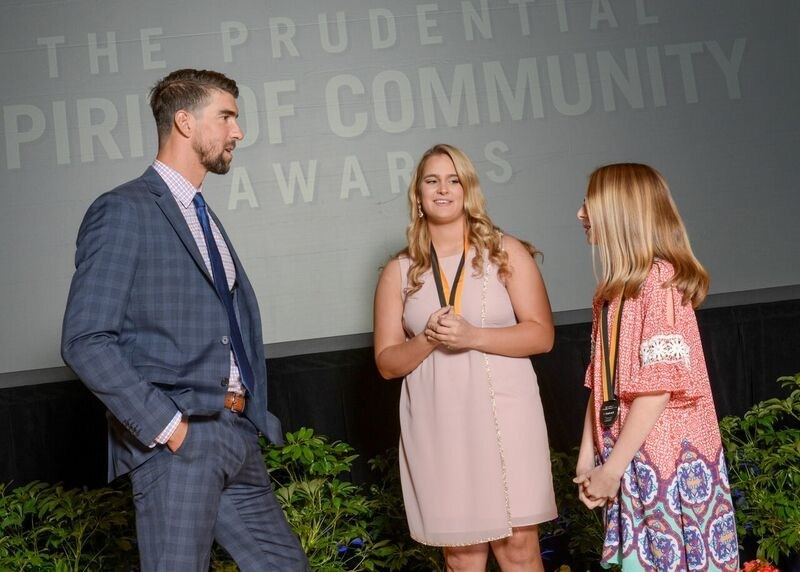 Olympic gold medalist Michael Phelps congratulates Elena Polinski, 17, of Moundsville (center) and Mallory Marks, 12, of Mineral Wells (right) on being named West Virginia's top two youth volunteers for 2017 by The Prudential Spirit of Community Awards. Elena and Mallory were honored at a ceremony on Sunday, May 7 at the Smithsonian's National Museum of Natural History, where they each received a $1,000 award.