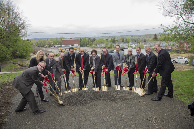 A group of dignitaries led by Cornell University President Martha Pollack (center) turn ceremonial dirt at a ceremony marking the start of construction of the Maplewood Graduate and Professional Student Housing, which is scheduled to open in Fall 2018.