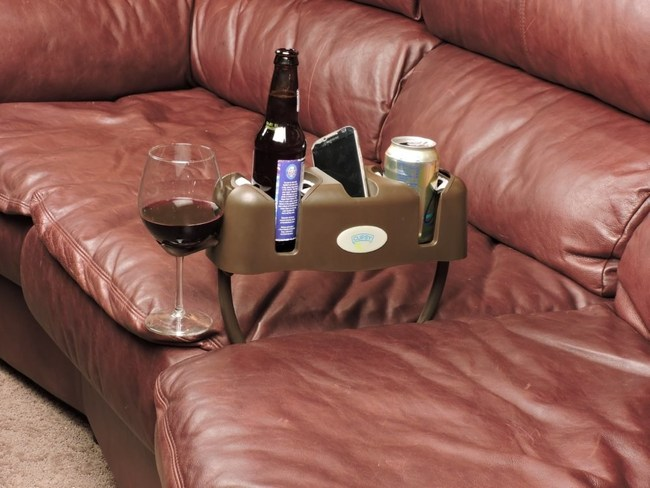 The repositionable legs on the Cupsy drink organizer allow it to be inserted between couch cushions, hung off the side of a bed, or layed on a bumpy bedspread