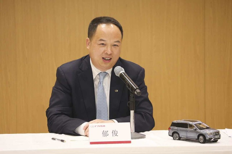Yu Jun, General Manager of GAC Motor, speaking at a press conference about the importance of the new industrial park for boosting GAC Motor's EV business)