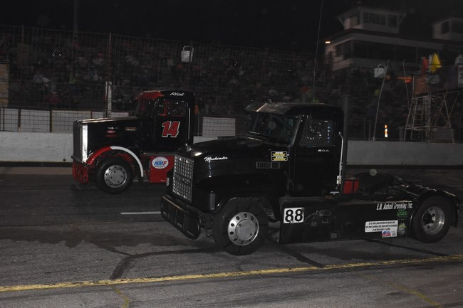Ricky Rude (#14) and Mike Morgan (#88) battle for position at Hickory Motor Speedway Saturday, March 25th