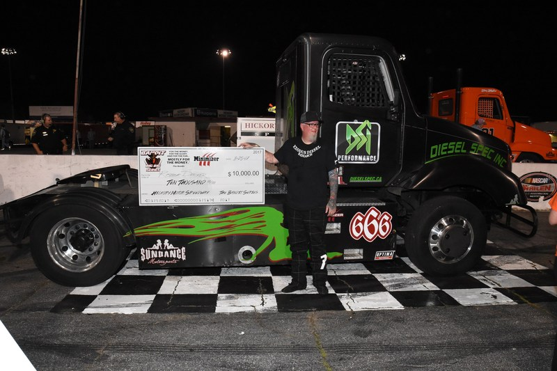 Robbie Decker (#66) celebrates his feature win with a $10,000 check at Hickory Motor Speedway Saturday, March 25th.