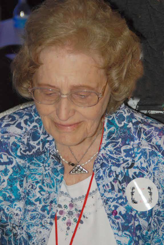 At a Carry The Load Memorial Day event last year in East Texas, U.S. Army (Ret.) Colonel David Dodd, director of Point 27--Strength for the Fight, presented this Gold Star widow of a WW II soldier a silver Folded Flag Shield of Strength pendant necklace. Her husband was lost when the plane he was in went down in a combat mission. It was decades later, when she received word from the military that his remains had finally been located.