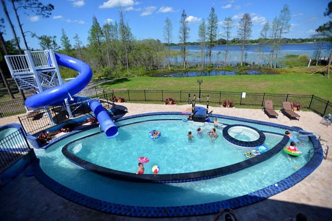 A 40,000 gallon pool in a 10-acre backyard complete with two waterslides, hot tub, outdoor TV, and lazy river