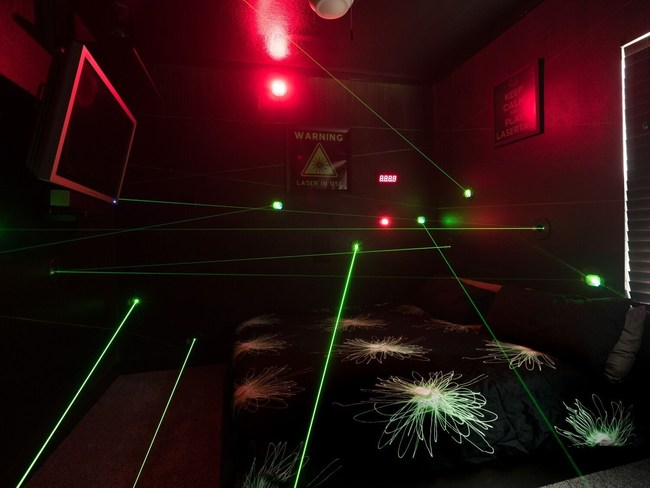 Guests dodge lasers in a race against the clock in this one-of-a-kind vacation home attraction.