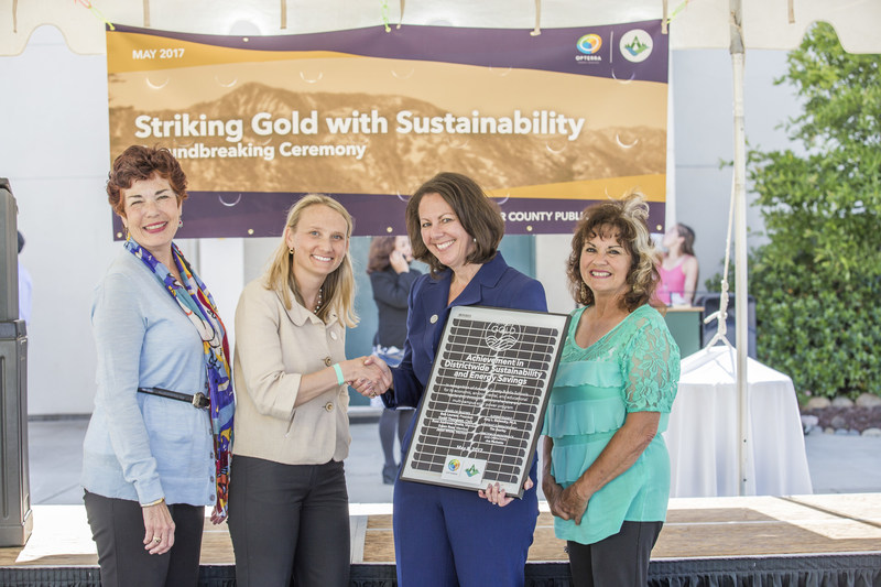 Members of the Amador County Public Schools Board celebrate the beginning of the Amador GOLD program with OpTerra Energy Services Senior VP Lindsey Nehls (second from L) and Superintendent Dr. Amy Slavensky (second from R) at District ground breaking event. Dr. Slavensky holds commemorative plaque marking beginning of the new sustainability and STEM-focused District initiative with OpTerra.
