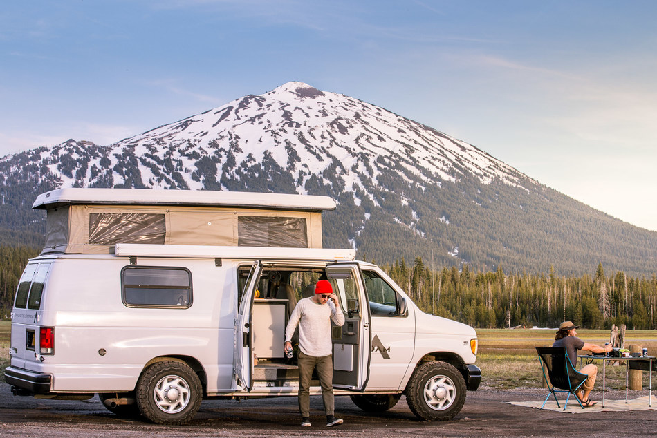 Setting up camp for the day is easy in a ROAMERICA campervan. Just pop the top, pull out the deluxe camp chairs and table, open a cold one, kick back and relax. Photo Credit: Mike Branscum @this.is.mike.
