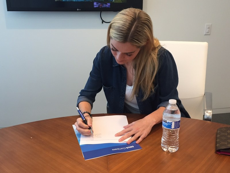Kealia Ohai signed her brand ambassador agreement with BBVA Compass at BBVA Compass Plaza in Houston last week.