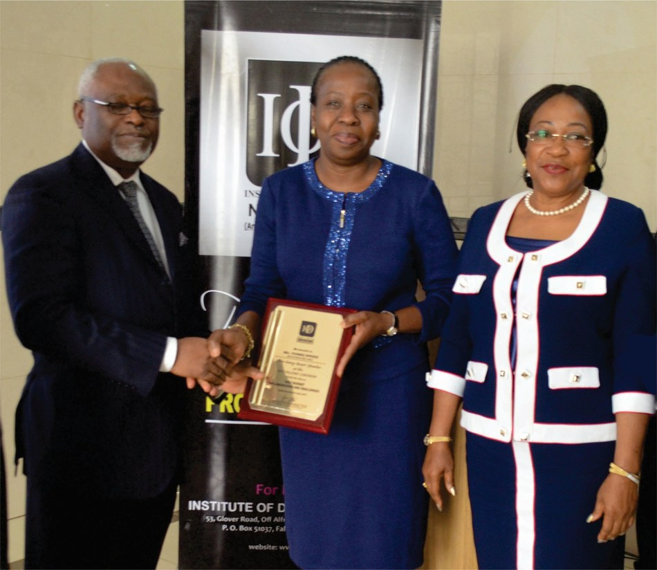 From L-R, President/Chairman of Council, IoD Nigeria, Mr. Samuel Yemi Akeju; CEO of MainOne, Ms. Funke Opeke; Chairman, IoD Fellows Committee, Ms. Bennedikter Molokwu at the 2017 Institute of Director Fellow Luncheon which held recently (PRNewsfoto/MainOne)