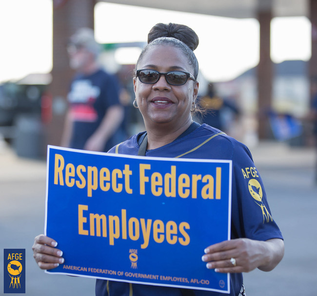 A member of the American Federation of Government Employees rallies for better working conditions outside Fort Gordon in Georgia in March.