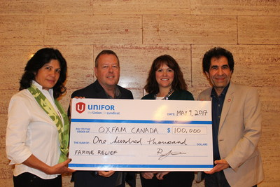 Unifor''s Robert Orr, National Secretary-Treasurer and Mohamad Alsadi, Director, Human Rights and International Department present donation to Oxfam Canada''s Nidhi Tandon, Board of Directors Member and Beth Dimsdale, Philanthropic Giving (CNW Group/Unifor)