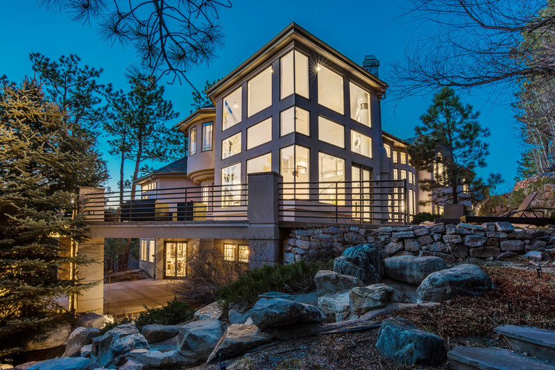 A luxury auction® sale has been announced for this impressive mountainside home in the Castle Pines Village community of Castle Rock, Colorado on May 20, 2017. Platinum Luxury Auctions is offering the property in cooperation with listing brokerage SCB & Associates. The property boasts a modern design, four finished levels, a resort-style spa and a 10-vehicle garage with detailing station and lounge. Discover more at CastleRockLuxuryAuction.com. (Pictured: The home's exterior at dusk).