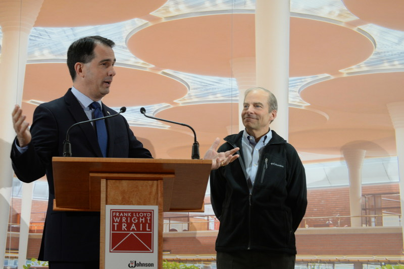 Wisconsin Gov. Scott Walker and Fisk Johnson, Chairman and CEO of SC Johnson at the official dedication of the state's Frank Lloyd Wright Trail in a ceremony in the Great Workroom of the company's Wright-designed Administration Building in Racine, Wisconsin.