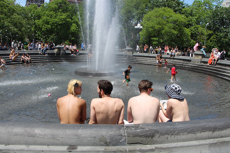 Women and men topless together in the fountain at Washington Square Park