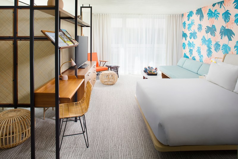 King beds, midcentury modern furnishings, a lanai and signature barkcloth-inspired wallpaper await guests in every spacious room.