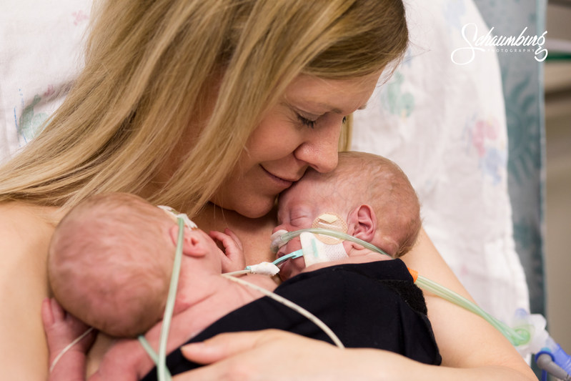 Kendra Fuemmeler of Kansas City, MO holds her premature twin boys, Miles and Maxwell, together for the first time since their birth on March 8, 2017. The March of Dimes and Saint Luke's Hospital of Kansas City are helping to make this Mother's Day extra special for Kendra and other moms in the Newborn Intensive Care Unit by providing support and personalized keepsake photos captured during skin-to-skin bonding. The boys were delivered at 25 weeks gestation after Kendra went into preterm labor.