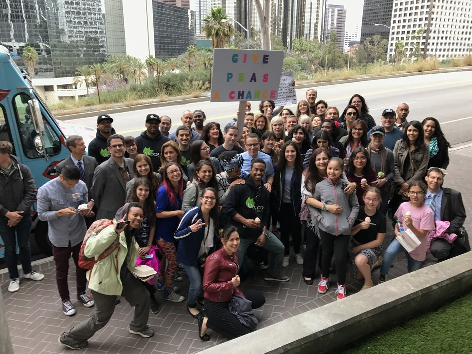 Students from the nonprofit Earth Peace encourage LAUSD board members to vote in support of a pilot program to test-drive daily plant-based vegan entrées and nondairy beverage options.