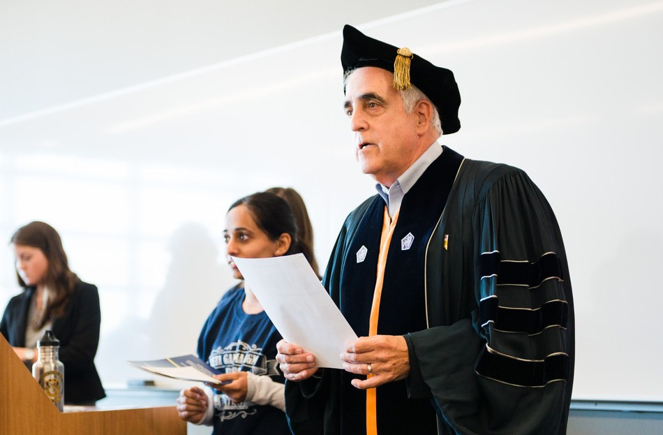"""Senior Associate Dean Martin Markowitz of Rutgers Business School-New Brunswick """"taps"""" students eligible to join the school's chapter of the Beta Gamma Sigma Honor Society."""