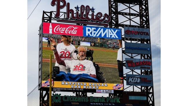 Chris, pictured here with his wife, Christine, are acknowledged during a pregame ceremony prior to the Phillies-Mariners game on May 9th. May is ALS Awareness Month.