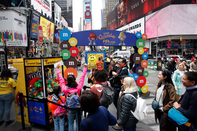 To celebrate the launch of M&M'S Caramel, M&M'S brought a whole new flavor of fun to New York's Times Square by transforming the area's iconic billboards into an innovative augmented reality gaming experience, Thursday, May 11, 2017, in New York. (Photo by Jason DeCrow/Invision for M&M'S/AP Images)