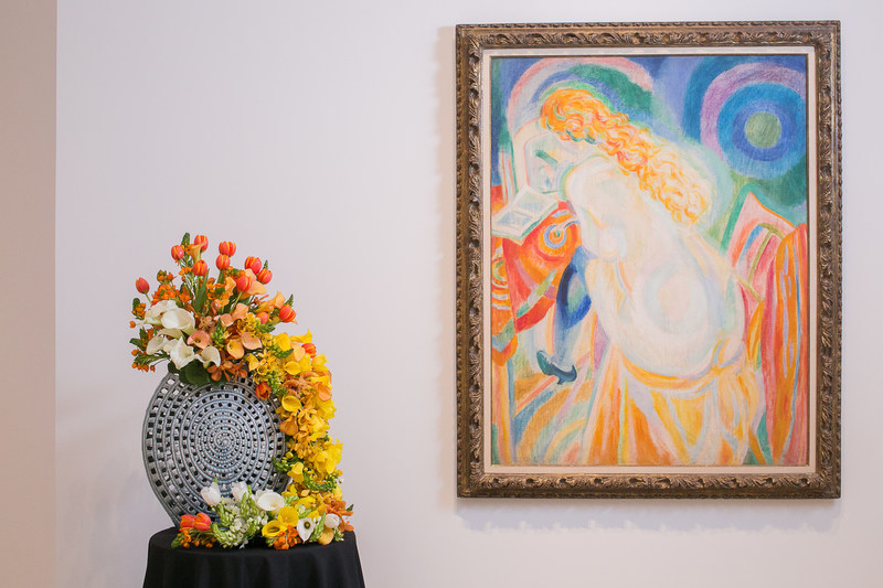 """ProFlowers' head floral designer Kate Law won top prize at the annual Art Alive Floral Exhibition with this floral interpretation of """"Female Nude Reading"""" featuring calla lilies, dubiums and tulips.  Photo Credit: The San Diego Museum of Art"""