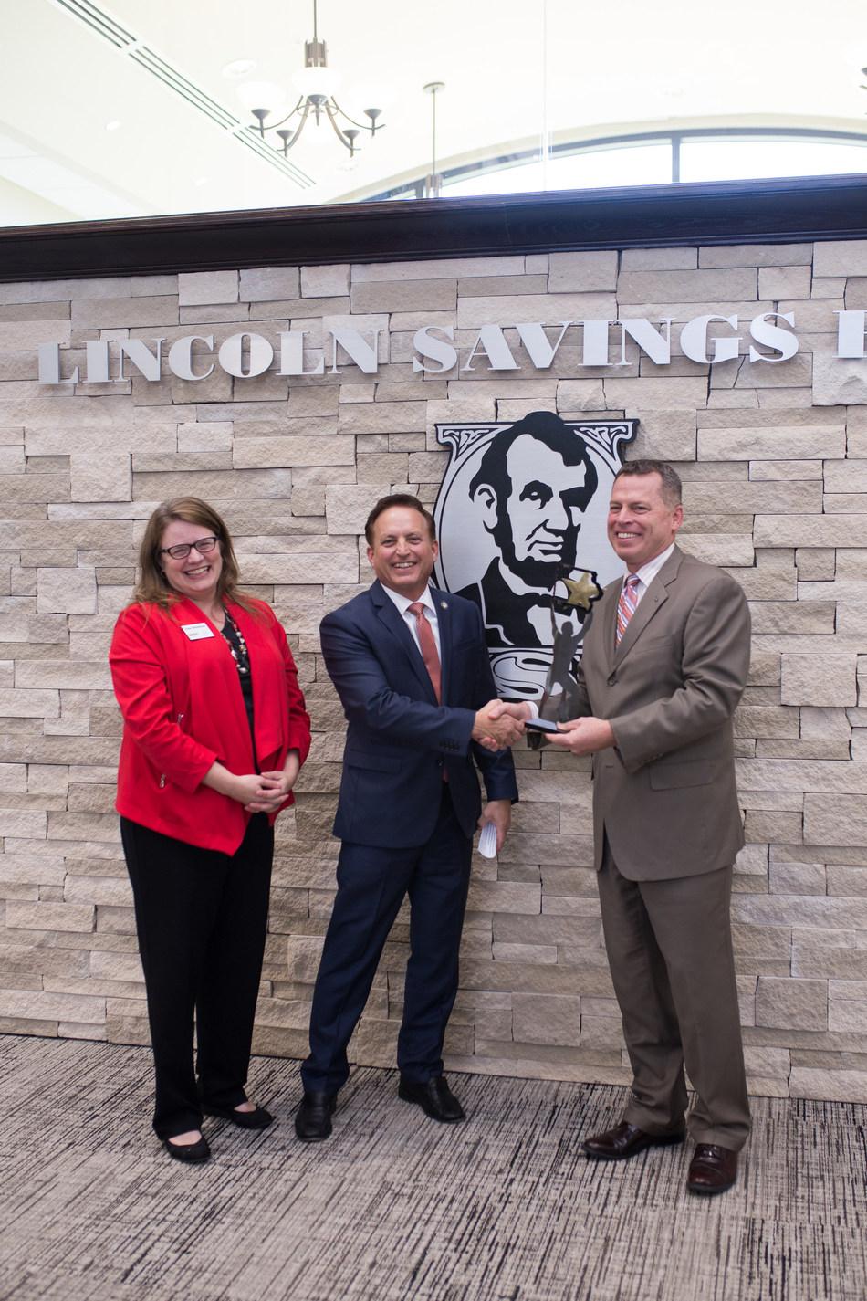 Iowa Secretary of State Paul Pate (center) and Lisa Shimkat, State Director of the Iowa SBDC (right) present SBDC Champion award to Erik Skovgard (left), LSB President and CEO
