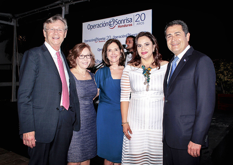 From left to right: Operation Smile Co-Founder and CEO Dr. Bill Magee, Operation Smile Senior Executive Advisor Beth Marshall, and Chair of the Board of Directors of Operation Smile Honduras Ana Kafie pose with the President of Honduras Juan Orlando Hernandez and the First Lady Ana Garcia de Hernandez at Operation Smile Honduras' 20th anniversary celebration.
