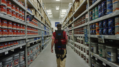 A Lowe's associate in Christiansburg, Va. walks down the aisle wearing an exosuit.