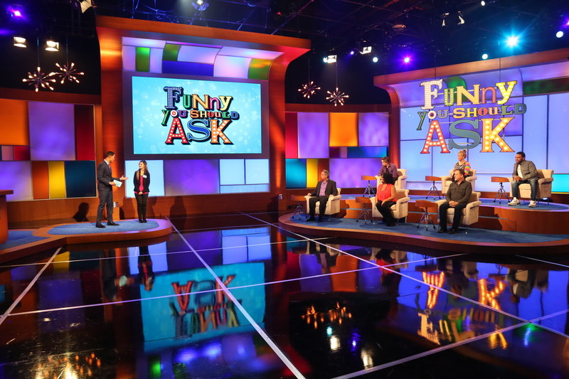Host JON KELLEY and a contestant on the set of Byron Allen's new daily comedy game show FUNNY YOU SHOULD ASK. Panelists (L-R): JON LOVITZ, PAULY SHORE, SHERRI SHEPHERD, CAROLINE RHEA, DAVE COULIER, and ANTHONY ANDERSON. Series is cleared in 95% of U.S. television markets and launches in September 2017 in broadcast strip syndication and cable.  Photo Credit: Dennis Hardison/Entertainment Studios