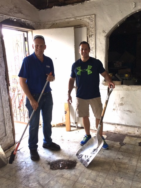 RCASF President, John Chase of Chase Roofing & Treasurer, Rob Foote, of Frank H. Furman Insurance assisting on clean up