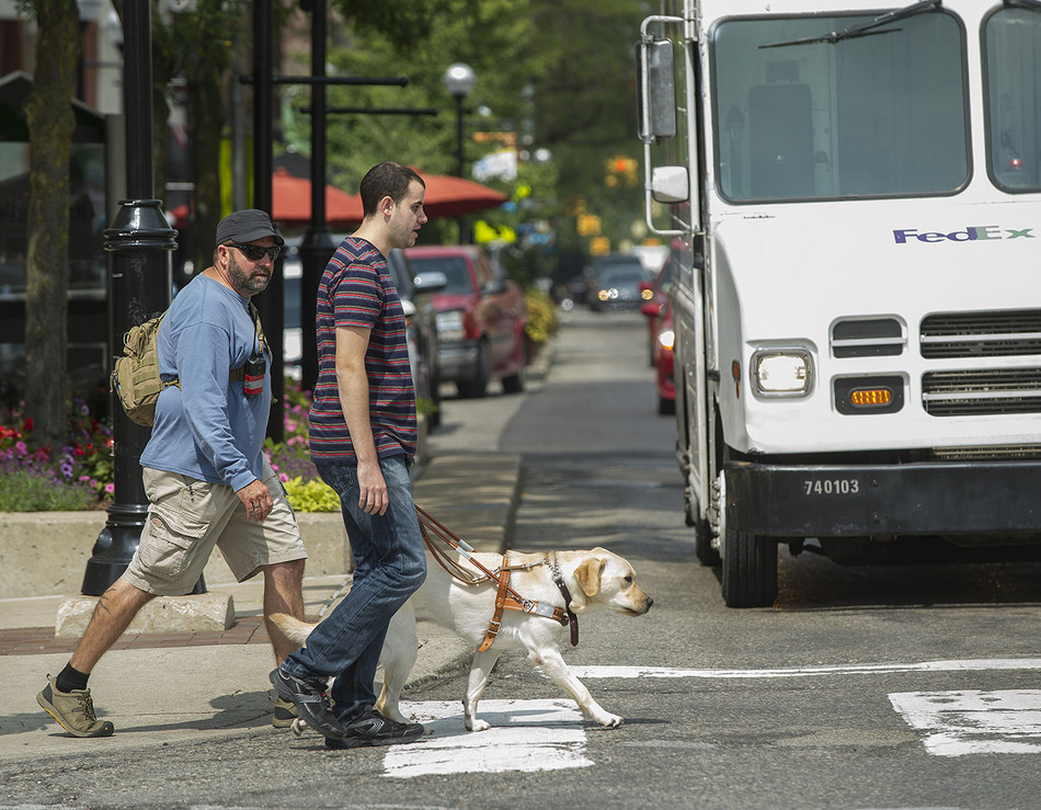 Leader Dogs for the Blind: client crossing street during training.