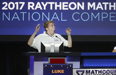 Luke Robitaille, the 2017 Raytheon MATHCOUNTS National Champion, answers the final question of the Countdown Round at the Hilton Orlando Lake Buena Vista, Florida. Robitaille, a 13-year-old 7th grader from Euless, Texas was among the 224 U.S. middle-school math students who took part in this year's competition. (credit Damian Strohmeyer Photography)