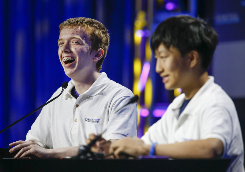 Luke Robitaille, a 13-year-old 7th grader from Euless, Texas (left), faces off against Texas teammate Andrew Cai (right), during the Countdown Round of the 2017 Raytheon MATHCOUNTS National Competition. Robitaille was named national champion and Cai was the runner-up. (credit Damian Strohmeyer Photography)